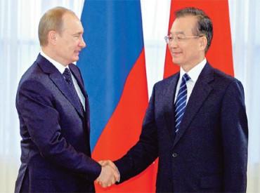 Wen Jiabao és Vladimir Putin megállapodtak a dollár mellőzéséről