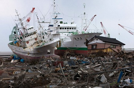 Ships sitting on a rice field amid rubble from the tsunami. Scientists believe the disaster moved the sea floor much further than originally thought