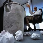 Businessman Filling Trash with Papers