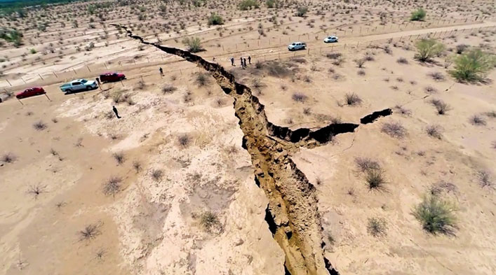 Large Holes Forming Near the New Madrid Fault and a Giant Crack in the Earth in North Mexico