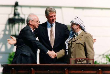 """Bill Clinton, Yitzhak Rabin, Yasser Arafat at the White House 1993-09-13"" by Vince Musi  / The White House"